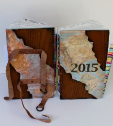 Wood veneers and maps are used for the covers.