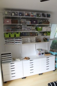 Shelving with drawer systems underneath. Subsequently added peg board under shelving.